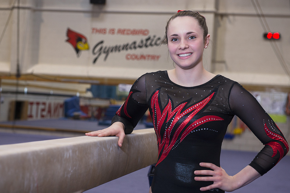 Gymnist Kylie Meyer next to her balance beam